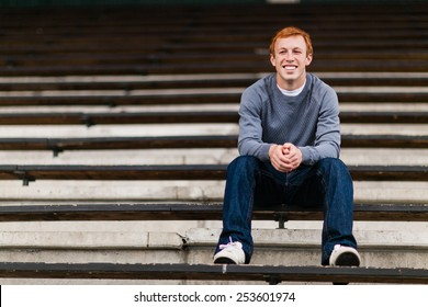 Athletic Attractive Young Male Outside sitting in bleachers