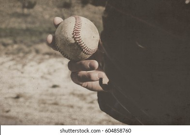 Athletic baseball background with vintage feel.  Ball player getting ready to pitch during game of catch.