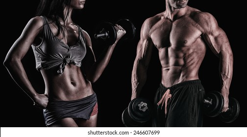athletic beautiful sexy young couple posing in studio