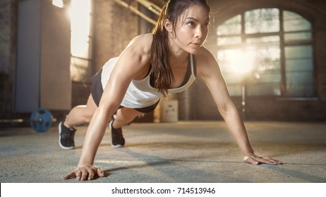 Athletic Beautiful Woman Does Push-ups as Part of Her Fitness, Bodybuilding Gym Training Routine.