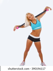 Athletic blond woman doing exercises. Isolated on a white background.