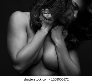 Athletic body of young woman over dark background