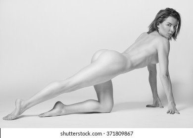 Athletic body of young woman over white background. Fitness concept.