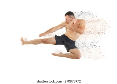Athletic boxer fighter performing a flying side kick isolated on white background