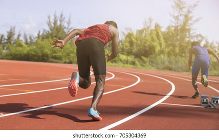 athletic boy running on stadium