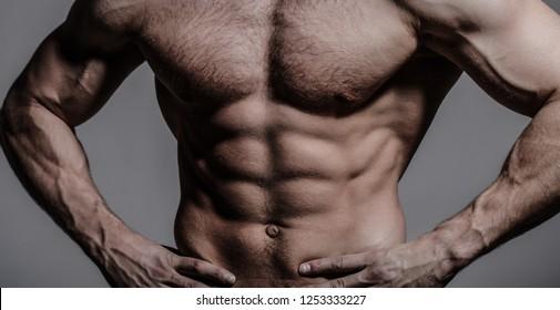 Athletic caucasian, sexual macho. Muscular athletic sexy male, naked torso. Muscular man, male naked, healthy muscular guy, torso man. Sexy man with muscular body and bare torso.
