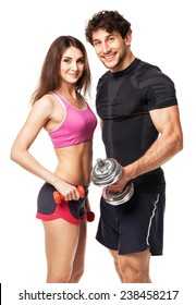 Athletic couple - man and woman with dumbbells on the white background