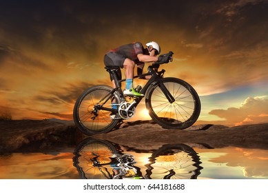 Athletic cyclist on the road in a beautiful area in the afternoo