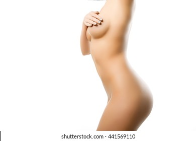 athletic female body on a white background. sekusalnyh naked woman. woman posing in the studio.