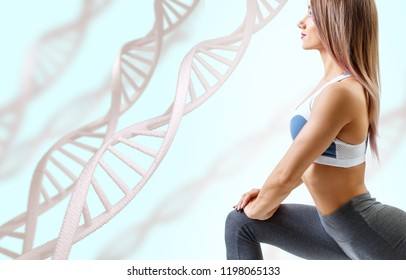 Athletic fitness woman standing among DNA chains. Metabolism concept. Over blue background.