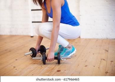Athletic girl doing fit in gym