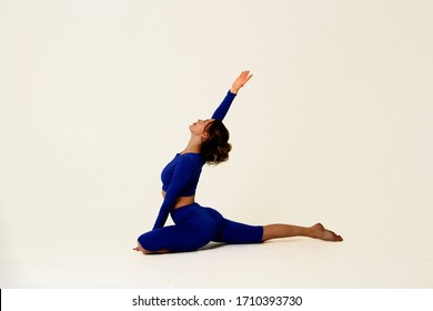 athletic girl is engaged in fitness yoga. Asanas on a white background