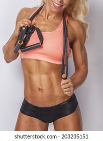 athletic girl in sport lingerie with resistance band