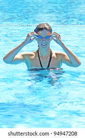 Athletic girl swimmer training hard in a swimming pool