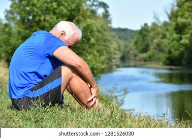 Athletic Grampa And Depression Sitting By River