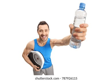 Athletic guy holding a weight scale and a bottle of water isolated on white background