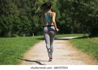 Athletic happy brunette woman working out in a meadow, from a complete series of photos