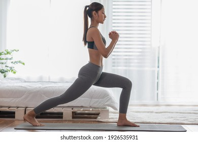 Athletic Healthy Asian indian woman in sportswear workout excercise at home in bedroom,Young woman with slim body cardio aerobic exercises healthy lifestyle concept