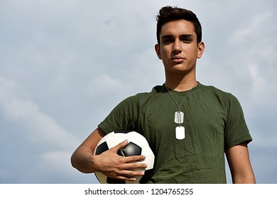 Athletic Hispanic Male Teen Soldier Posing
