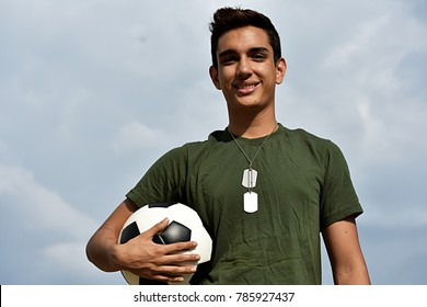 Athletic Hispanic Male Teen Soldier And Soccer