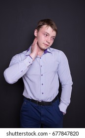 athletic man in a business suit. the concept of an office worker. emotional portrait. problem skin and short hair. a man in a shirt and pants