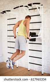 Athletic man doing fit in gym