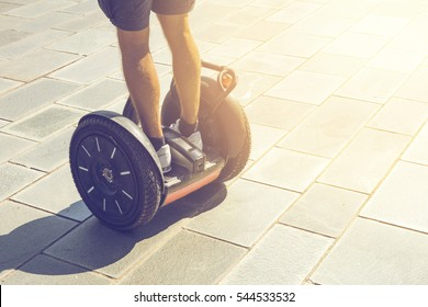 Athletic man driving on segway outdoors in Barcelona on a sunny day.