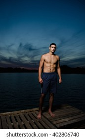 Athletic man in the evening near the river