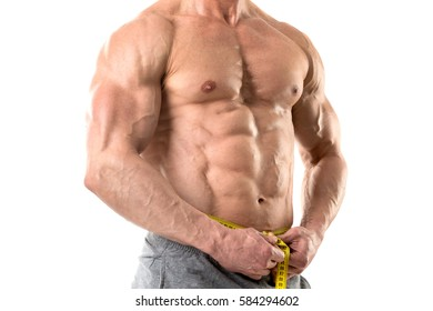Athletic man with great body, measuring his waist isolated in white