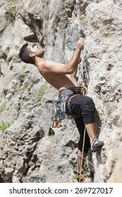 Athletic man practicing climbing