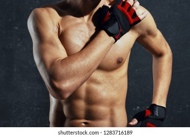Athletic man with a pumped up gloved hand