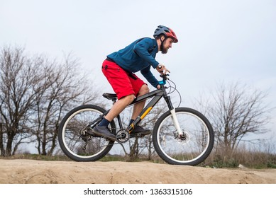 Athletic man riding a bike. Active lifestyle.
