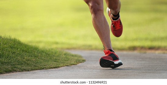 Athletic man running in the nature,healthy lifestyle