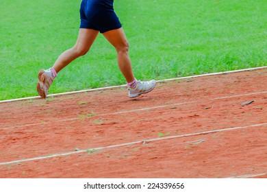 Athletic man running on track