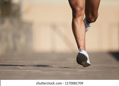 Athletic man running in the road ,healthy lifestyle
