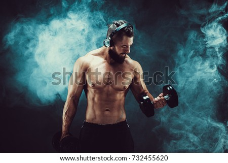Athletic man training muscles