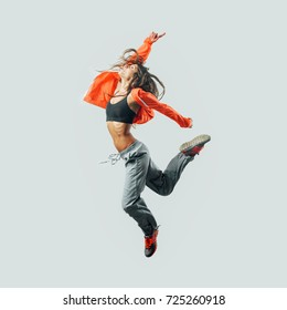 Athletic modern style dancer jumping, energy and fitness concept