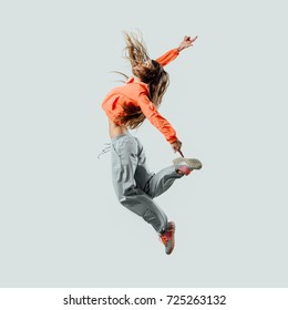 Athletic modern style dancer jumping and moving, energy and fitness concept