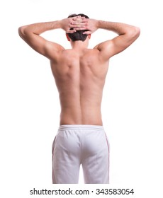 Athletic muscular male body. body-building. standing back