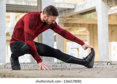 Athletic, muscular man stretching out and warming up for a workout