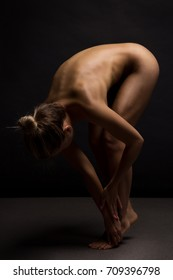 Athletic Naked woman body sculpture. Fine art photo of female body.
