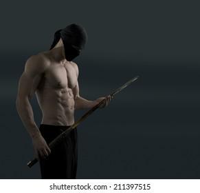 Athletic ninja with katana sword on a dark background