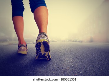 an athletic pair of legs going for a jog  - healthy lifestyle concept