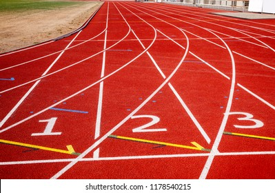 Athletic running track with lane numbers at a stadium