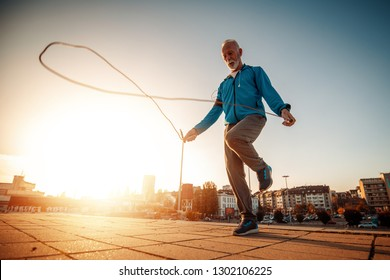 Athletic senior man running in the city.Sport,fitness,people and lifestyle concept.