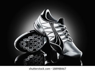 Athletic shoe on black background
