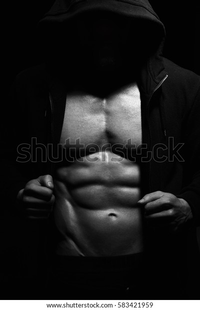 Athletic Strong Sexual Man Abs Six Pack Muscles Bodybuiding And Fitness Concept. Studio shot, Monochrome, Black and White