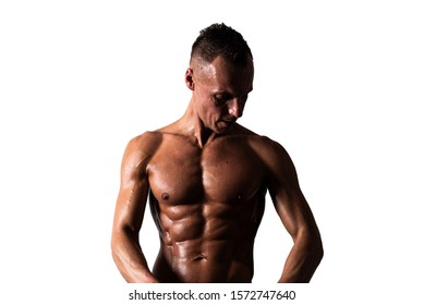 Handsome sexy male bodybuilder athlete man with naked torso, Poses showing a powerful