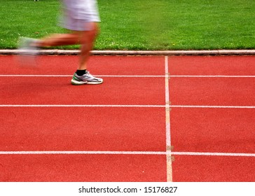 Athletic track with runner in motion