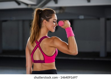 Athletic woman doing exercise for arms. Fitness model working out with dumbbells. Woman exercising with dumbbells. Fitness, workout, healthy living and diet concept. woman doing gymnastic exercises.